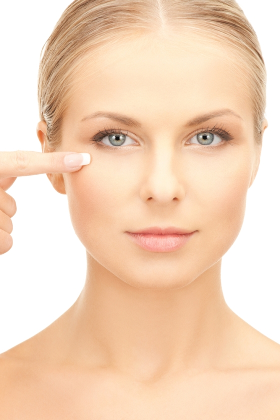 Woman pointing to her eye area