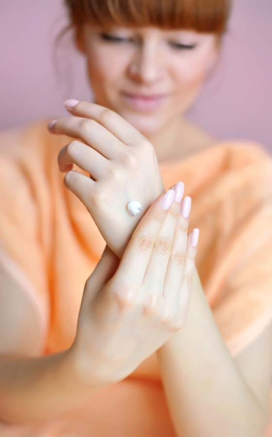 Applying moisturizer to hands