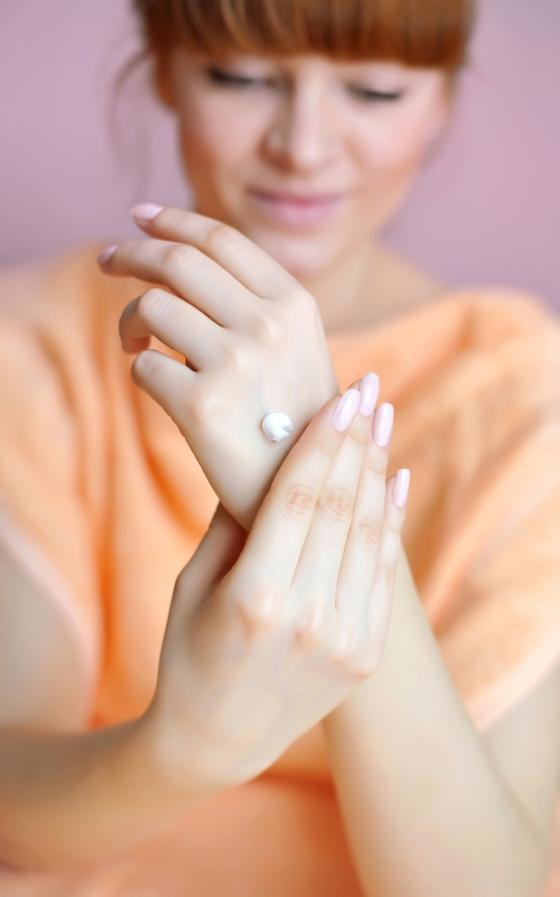 Applying moisturizer to hands