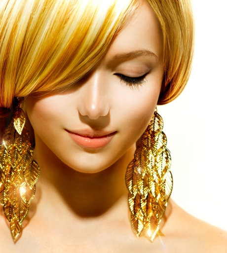 Gold chandelier earrings add a statement to your outfit