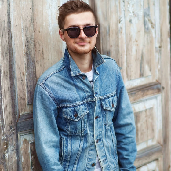 Stylish man in sunglasses and denim jacket