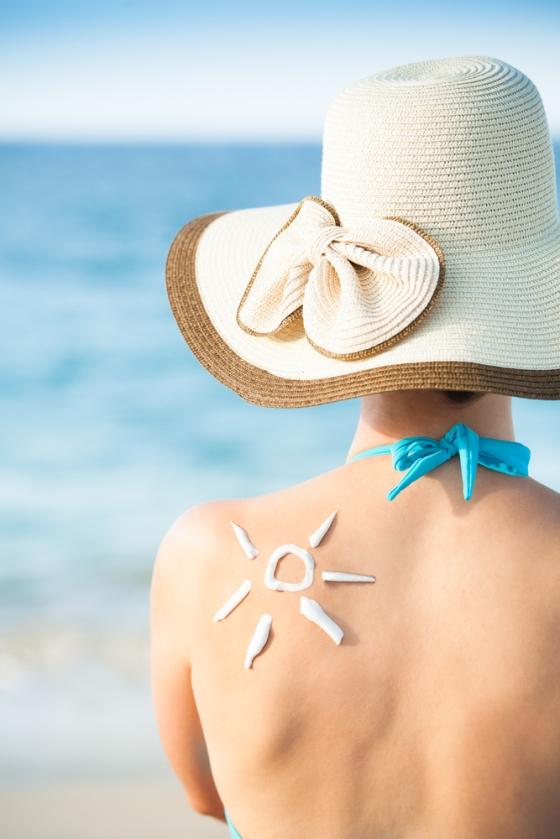 Sunscreen sun on a woman's back