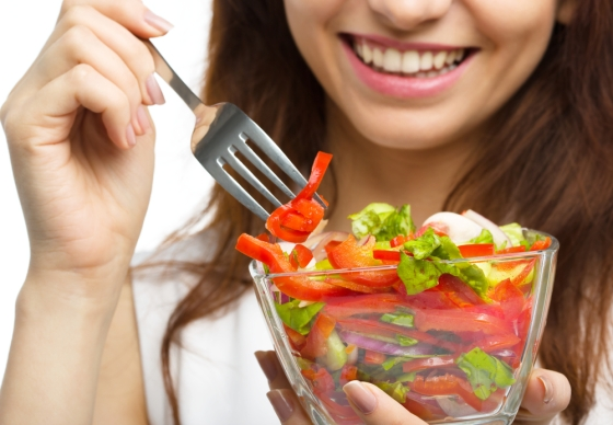 Young lady eating healthy salad