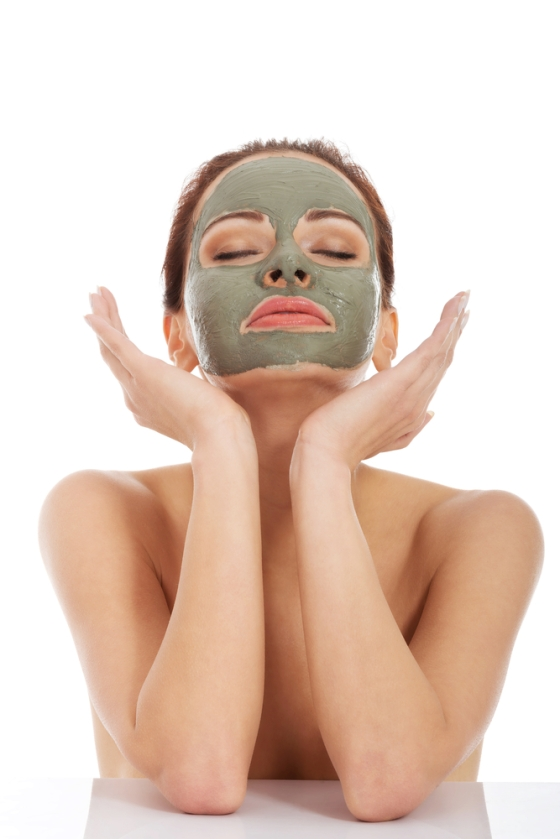 Young woman with green facial mask