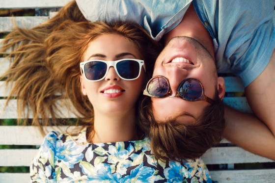 Young man and woman hanging out in their sunglasses