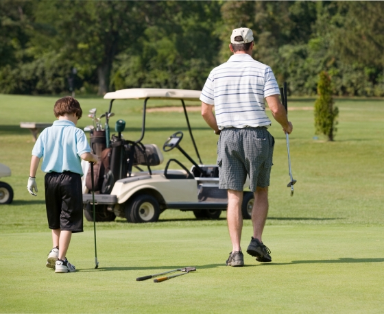 Father and son at golf range