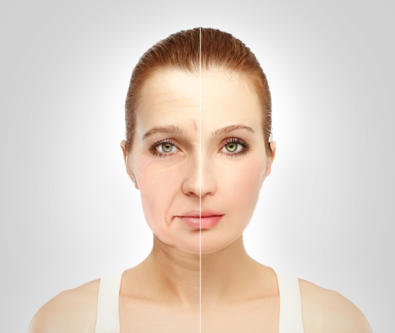 Aging shown on woman- half mature skin, half young skin