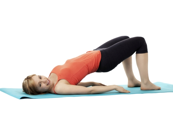 Bridge and pike exercise on yoga mat