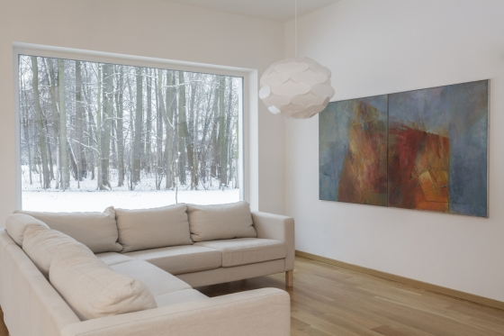 Large painting hanging in living room