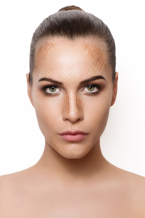 Womans face showing marks for contouring and highlighting
