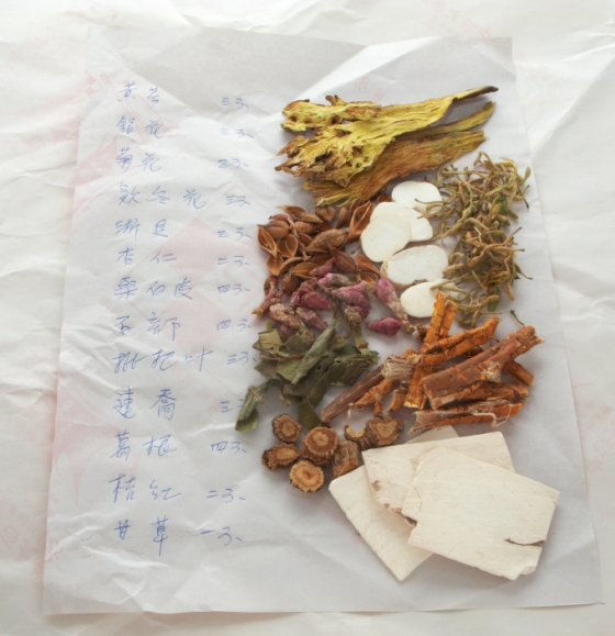 Traditional Chinese medicine prescription note with herbal medicine