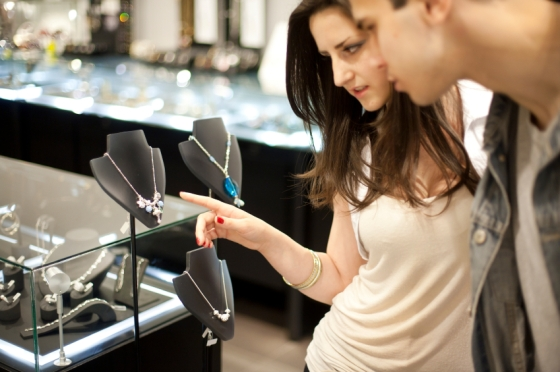 Attractive young couple looking at an expensive necklace in a jewelry store