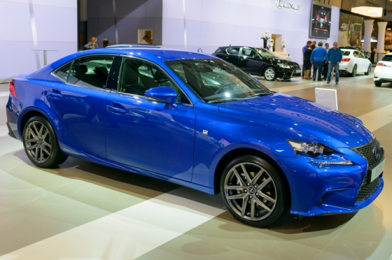 Lexus IS 350 F SPORT sedan on display at the 2014 Brussels motor show. People in the background are looking at the cars.