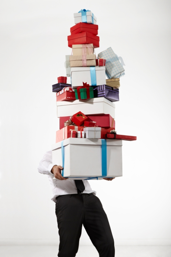 Husband with a huge stack of gift boxes