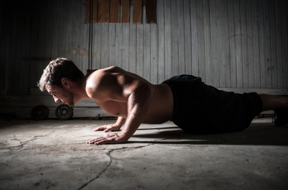 Man doing pushups as part of body weight workout