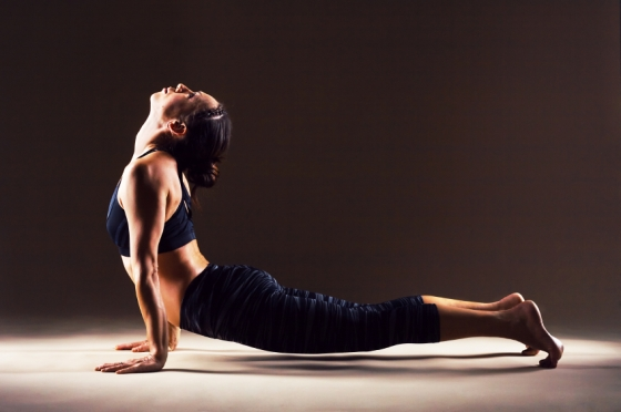 Beautiful sporty woman is doing Pilates: upward-facing dog,