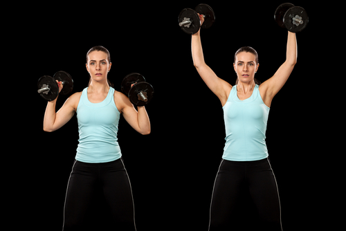 Woman doing dumbbell shoulder presses
