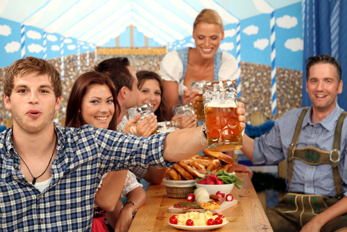 Waitress serves beer in Oktoberfest