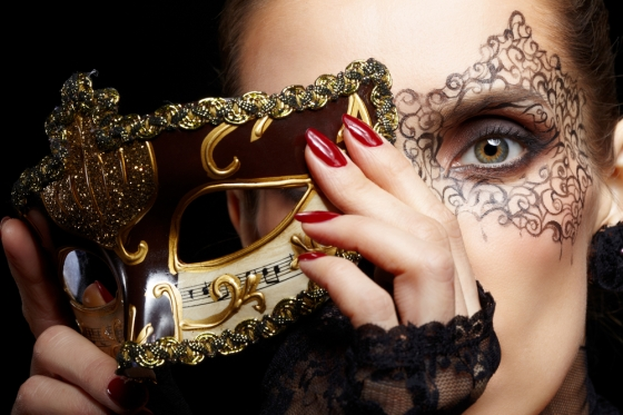 Woman with lace makeup wearing a mask for the Venetian ball.