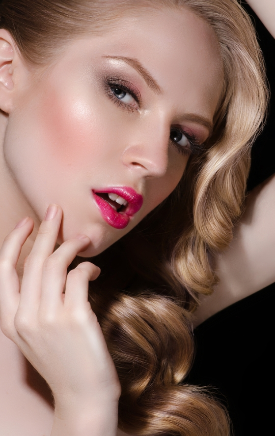 Beautiful girl with a rosy glow, blond hair and bright red lips.