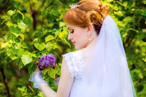 Bride wearing a lilac colored wedding dress.