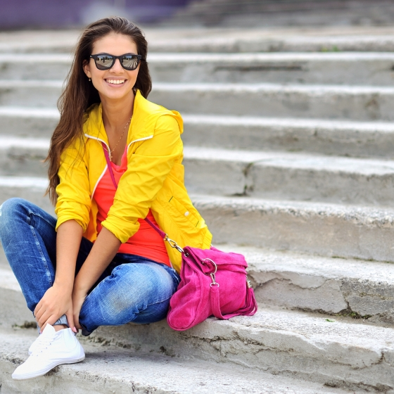 Beautiful girl wearing colorful clothes and sunglasses