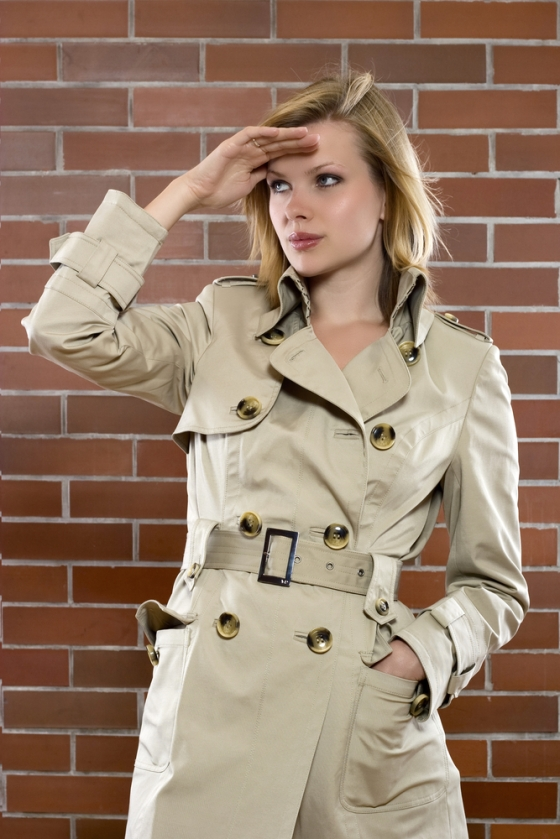 Young woman in a trenchcoat