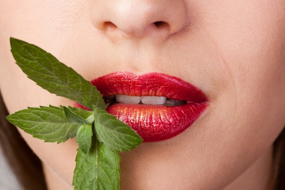 Closeup of kissable lips with red lipstick.