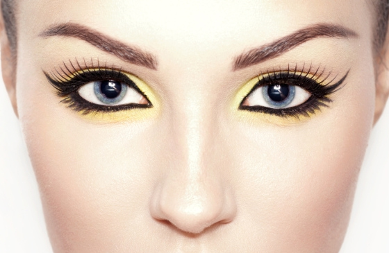 Image of a young woman with cat eyes makeup.