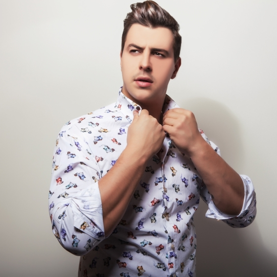 Handsome man wearing a shirt with unusual prints.
