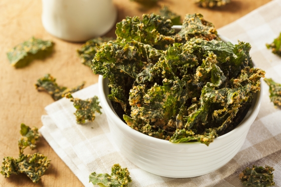 Bowl of baked kale chips.