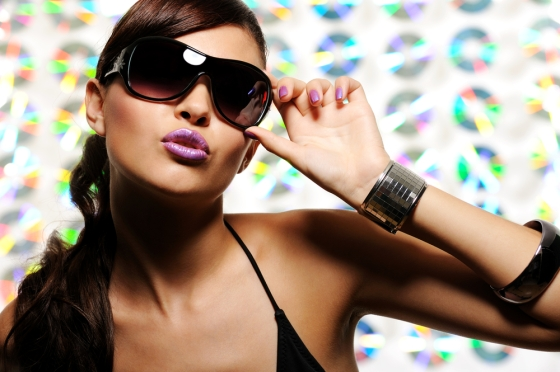 Woman wearing sunglasses with a pout.