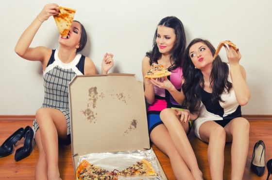 Group of friends having a pizza at home.