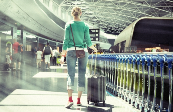 Woman wearing simple clothing at the airport.