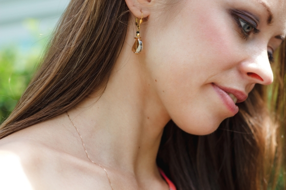 Close up of a woman wearing minimal jewelry