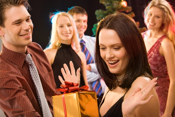 Woman receives a gift at a party.