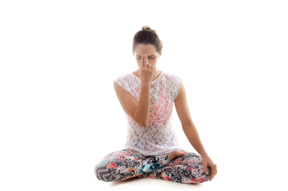Woman practicing pranayama before going to bed.