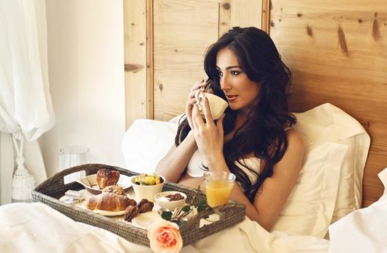 Woman having her breakfast in bed.
