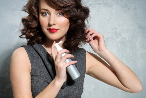 Woman using a hair spray
