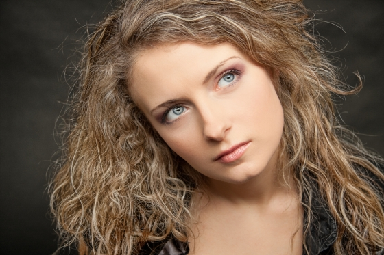 Woman with frizzy hair.