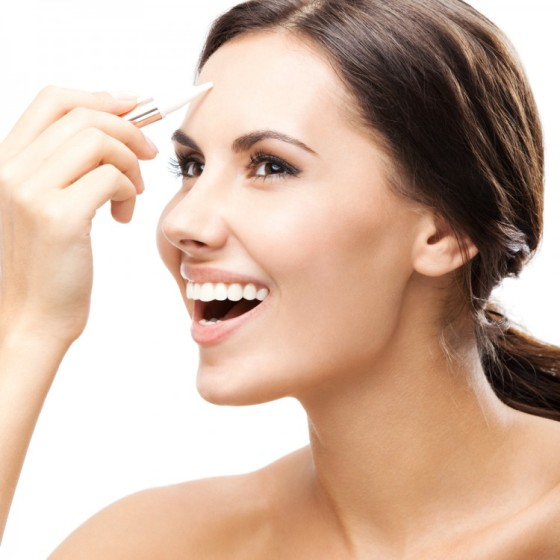 Woman applying a concealer