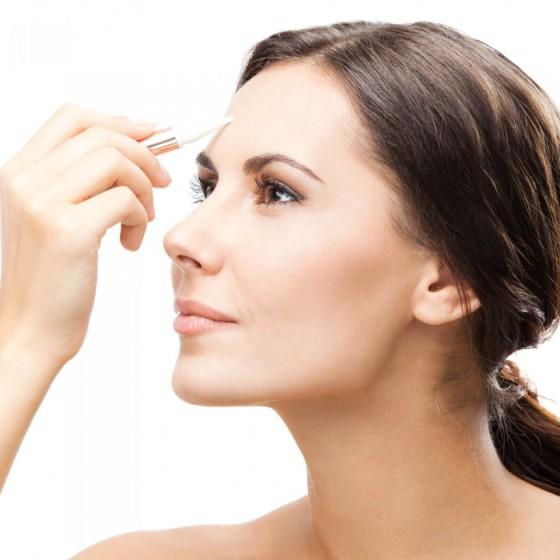 Woman using a concealer
