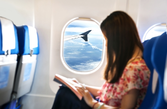 Woman reading a book in an airplane