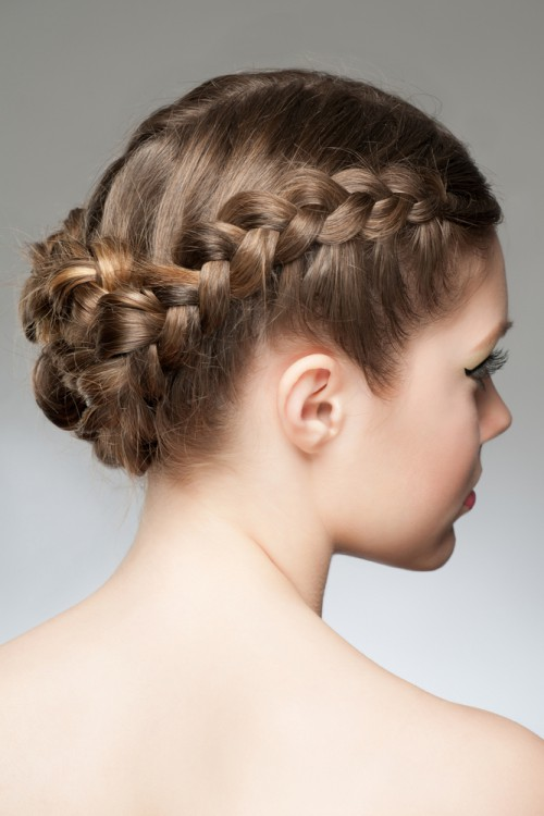 Woman with a braided bun hairstyle.