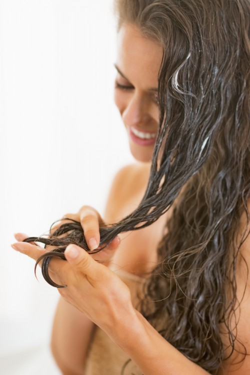 Woman conditioning her hair