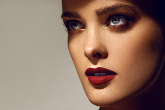 Woman wearing a dark lipstick color.