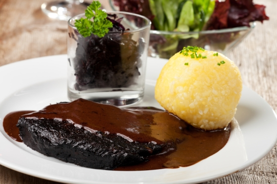 Sauerbraten dish with potatoes.