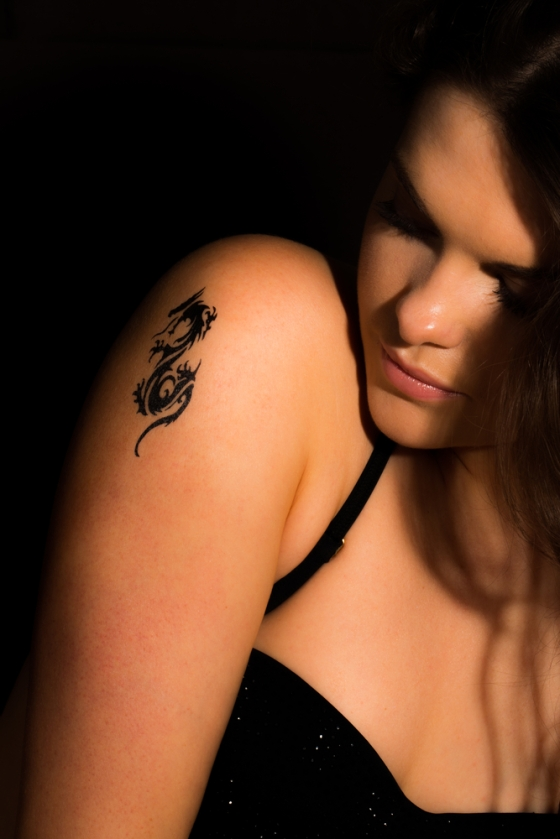 Woman with a tattoo on her shoulders