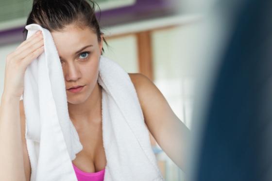 Woman taking a break in the gym.