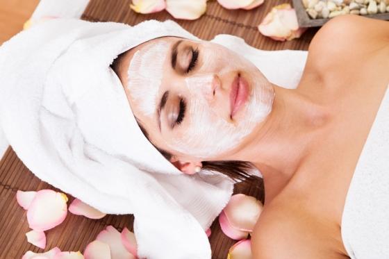 Woman getting a facial treatment in a spa